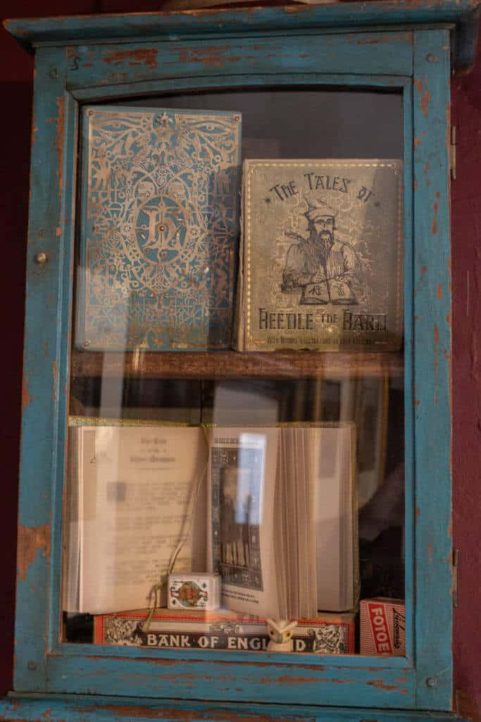 Display case of books from Harry Potter series at the House of MinaLima Harry Potter gallery London