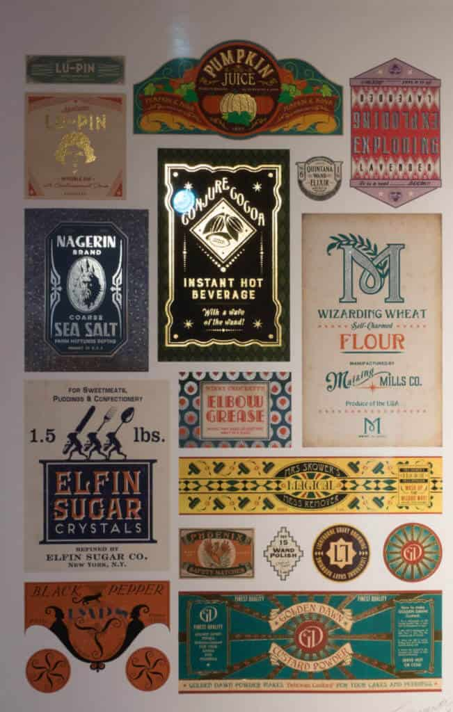 Display of product labels from Harry Potter and JK Rowling's Wizarding World at House of MinaLima Harry Potter gallery London