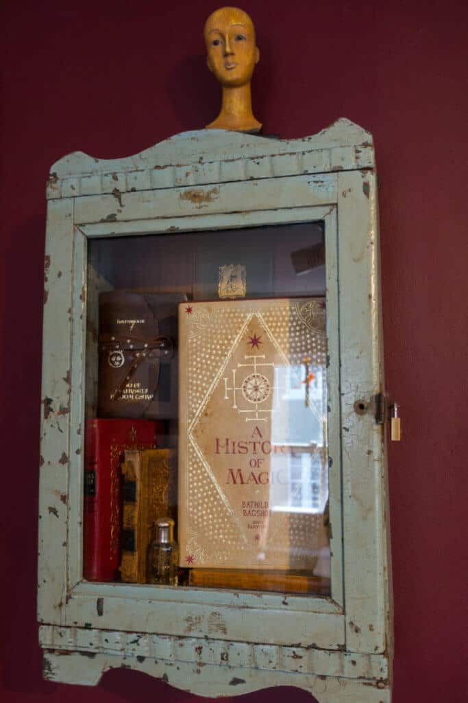 Display case of Harry Potter wizarding books at the House of MinaLima Harry Potter gallery London