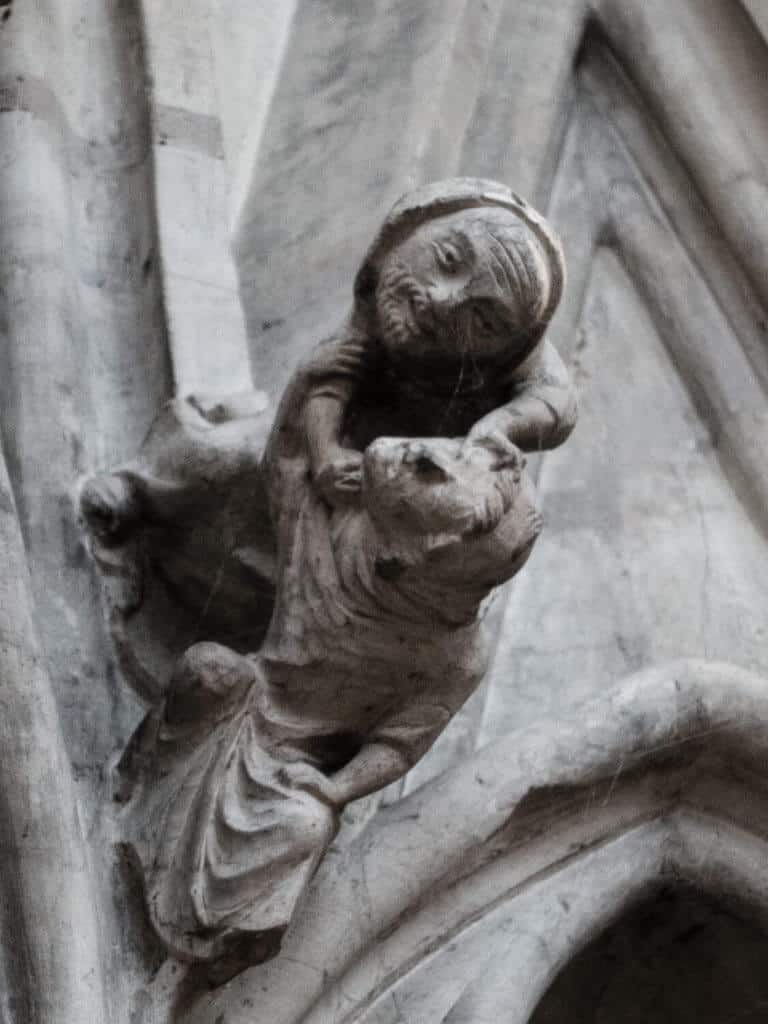 Fighting figures among the York Minster chapter house carved heads