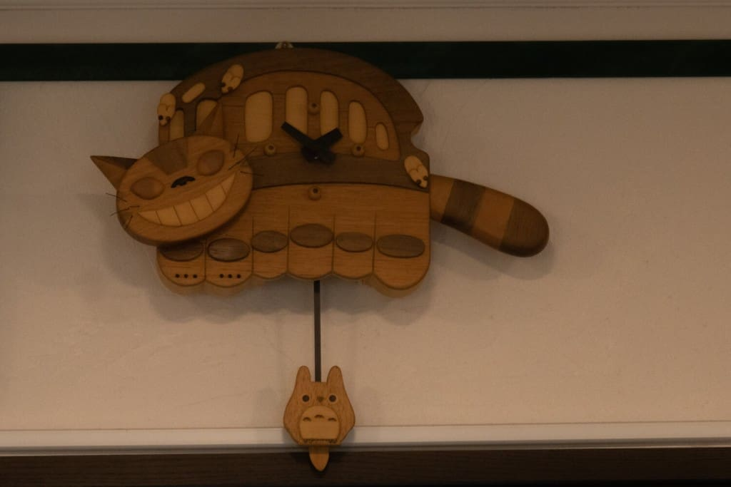 Wood Catbus clock at Shirohige Cream Puff Factory Totoro Cafe Totoro Cream Puffs